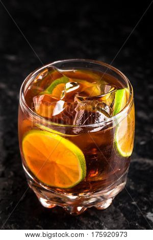 Cuba libre in a small glass on marble table