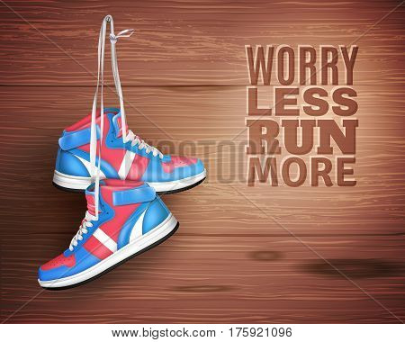 Pair of sports shoes hanging on nail in wood background with description worry less run more realistic vector illustration