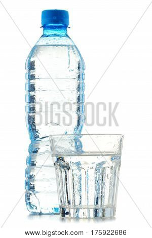 Bottle And Glass Of Mineral Water Isolated On White