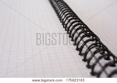Closeup of spiral metal binding notebook. Shallow depth of field.