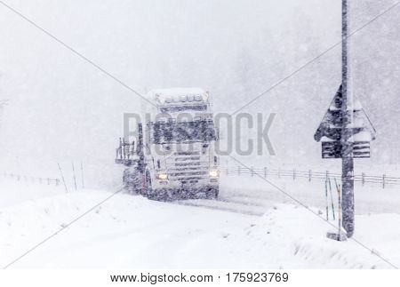 UMEA, SWEDEN ON MARCH 02. View of a modern highway, the traffic in snowy condition on March 02, 2017 in Umea, Sweden. Trees in the background. Editorial use.