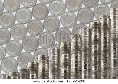Rows of coin stacks on coins background (one polish zloty. Slanted decoration with money.