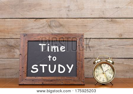 Alarm Clock And Blackboard With Text