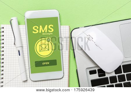 Sms Messages Word Display On Cellphone Screen Office Desk, Top View.