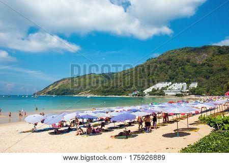 Phuket, Thailand - February 5, 2017: Tourists on the Nai Harn beach - one of the best beaches in Phuket