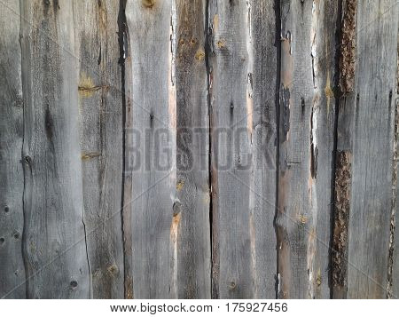 infinitely long and high fence of old boards