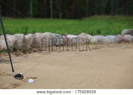 Golf Ball In Sand Bunker