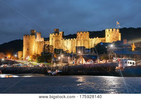 Conwy Wales United Kingdom - September 16 2016: World heritage Conwy castle in Wales at night. It was built between 1283 and 1289 and considered as one of the finest examples of late 13th century and early 14th century military architecture in Europe.