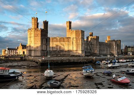 Caernarfon Wales United Kingdom - September 19 2016: Evening view of Caernarfon Castle with its polygonal towers in North Wales