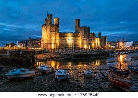 Caernarfon Wales United Kingdom - September 19 2016: View of Caernarfon Castle with its polygonal towers in North Wales