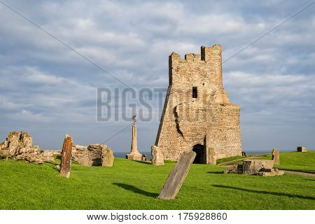 Aberystwyth Wales United Kingdom - September 21 2016: View of remains of the north tower gateway at Aberystwyth Castle. Building work started in 1277 at the time of the First Welsh War. War Memorial is visible on background.