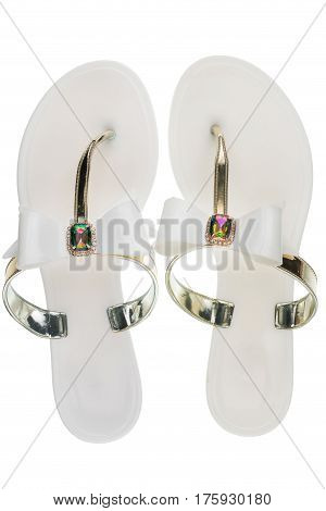 Pair of white beach sandals in rhinestones isolated on white background. View from above