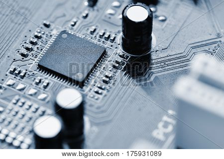 Components on board. PCB to PC. Chip capacitor and connectors on the motherboard of a personal computer. Modern technological background.