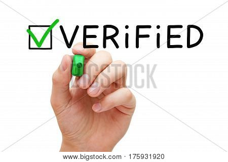 Hand putting check mark on Verified with green marker isolated on white.