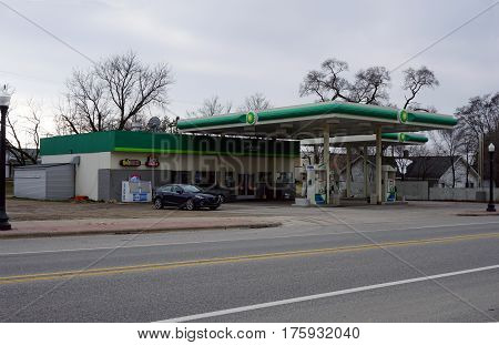 MANCELONA, MICHIGAN / UNITED STATES - NOVEMBER 27, 2016: One may purchase gasoline at the BP gasoline station in downtown Mancelona.