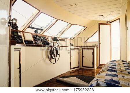 Captain's Cabin And Steering Wheel, Close-up On A Yacht