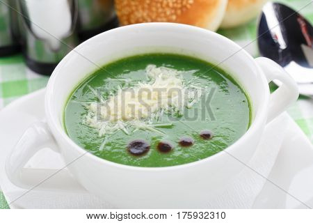 Bowl of delicious broccoli soup on a table