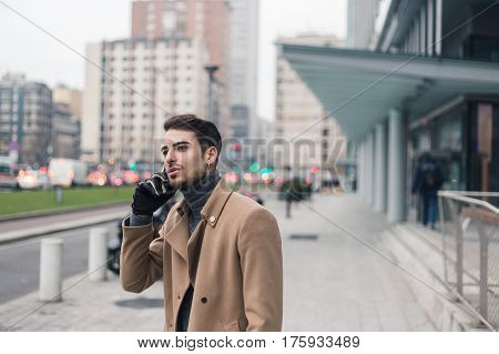 Beautiful Young Man Talking On Phone
