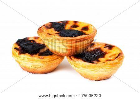 Creamy sweet egg curstard with black crust and sugar powder isolated on white. Pasteis de Nata egg tart