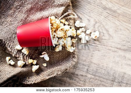 Homemade Kettle Corn Popcorn on wooden background - cinema movies and entertainment concept