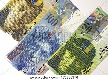 Swiss Franc Banknotes Of Different Denominations On White Background.