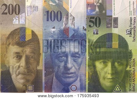 Swiss Franc Banknotes Of Different Denominations. Money Background.
