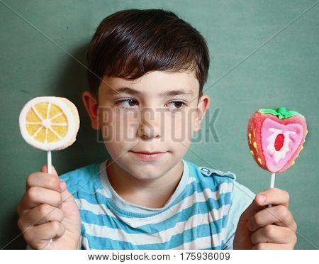 Preteen Handsome Boy With Two Marshmellow Sweets On Stick Isolat