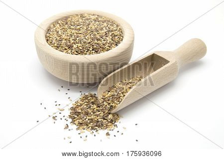 Flax chia and sesame seeds in wooden scoop and bowl on white isolated background