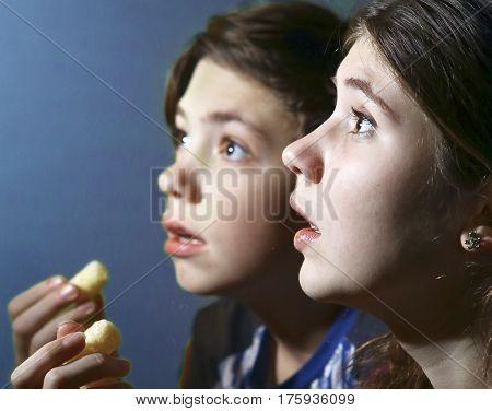 Kids Watching Horror Movie Film With Pop Corn