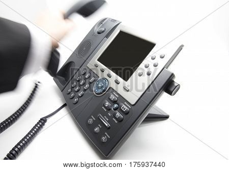 Businessman is picking up / hanging the phone receiver