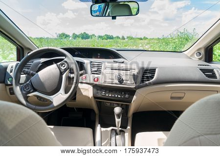 car windscreen with summer field, view inside out