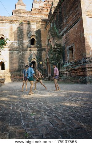 Myanmar Pagan - 06.11.2011: Locals play with kicking ball chinlon in the popular game sepak takraw