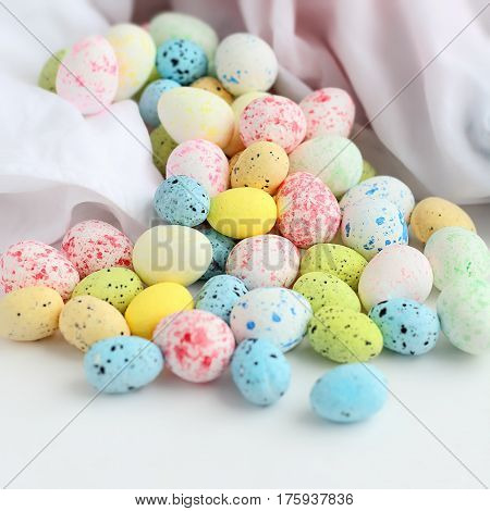 Easter stilllife. Colored eggs on a white background