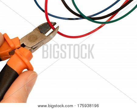 Cutting red wire by wire cutters. Safety precautions bomb neutralization