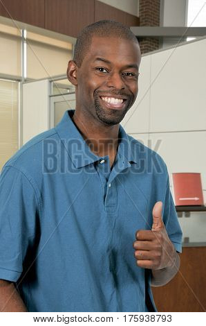 Handsome man gesturing with a thumbs up