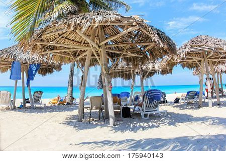 cuban beach in varadero with palms parasol