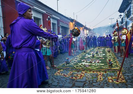 Antigua Guatemala - April 17 2014: Man wearing purple robes and ancient Roman military clothes during the Easter celebrations in the Holy Week in Antigua Guatemala.