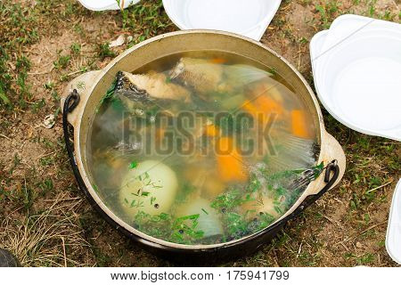 Bowler With Soup And Dishes. Fish Broth.