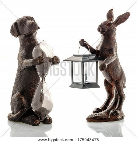 Decorative figurines, statuette of a dog and a hare, accessories for an interior, isolated white background