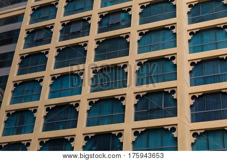 Beautiful openwork facade of modern high-rise building with windows close-up