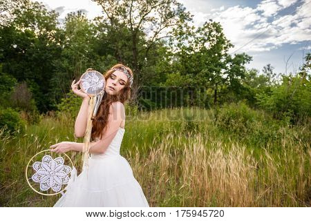 young redheaded girl smiling, Girl holding guardian, beautiful redheaded young girl, Girl holding dreamcatcher