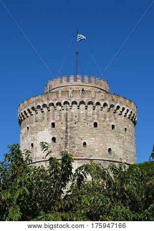Vintage White Tower against the blue sky in Thessaloniki Greece.