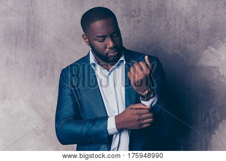 Close Up Portrait Of Handsome Bearded Afroamerican Man In Formalwear Fasten Cufflinks