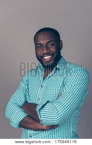 Portrait Of Successful Serious  Handsome Afroamerican Man In Shirt Crossed Hands And Smiling