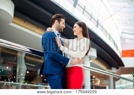 Side-view Portrait Of Happy Successful Lovely Young Family Hugs Each Other And Laughing, Walk In Mod