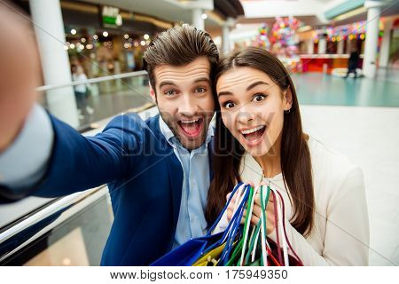 It's Shopping Time With Crazy Sales And Fun. Selfie Portrait Of Cheerful  Successful Happy Young Lov