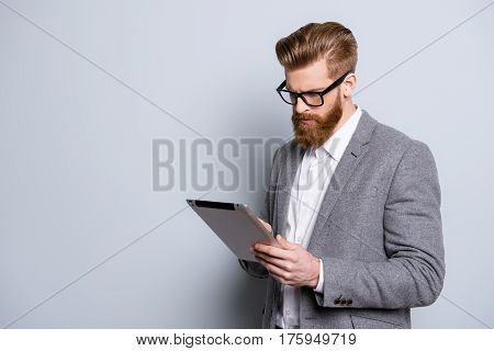Portrait Of Serious Confident  Bearded Man In Formalwear Holding Digital Tablet And Work