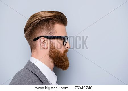 Side View Portrait Of Serious Smart  Confident  Bearded Man In Formalwear And Spectacles Looking At