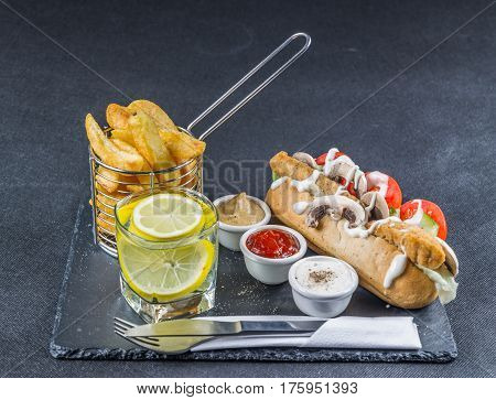 Crusty Herb Bread With Southern Fried Chicken, Mayonnaise, Lettuce, Tomato, Mushrooms, Three Sauces,