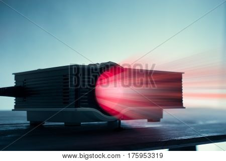 Mini Led Projector On Table In Dark Blude Tone Projector Home Theater Background.
